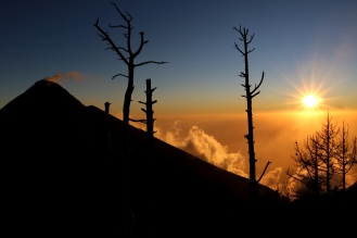 Enjoying the view of the sunset and Fuego Volcano